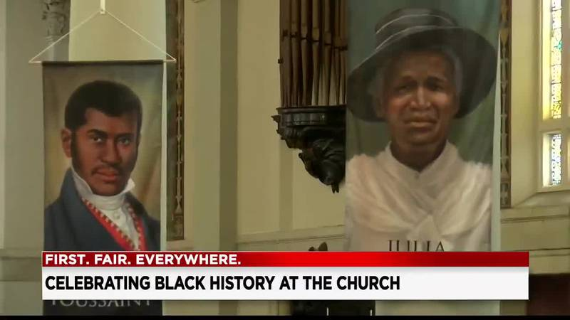 St. Aloysius-St. Agatha Church displays banners of Black Catholics who are on the road to...