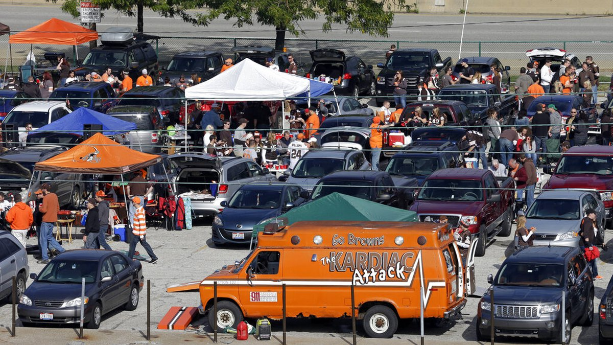 Fans tail gate in the municipal parking lot before an NFL football game between the New Orleans...