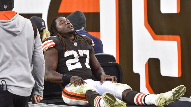 Cleveland Browns running back Kareem Hunt (27) is carted off the field after an injury during...