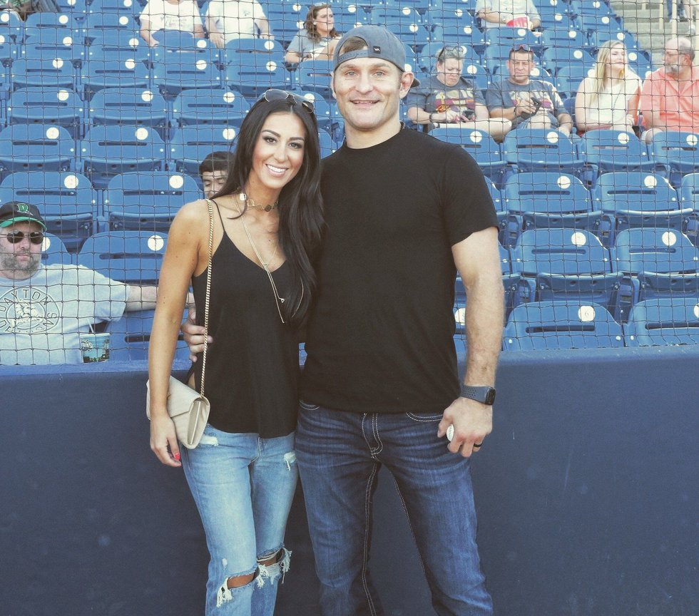 Stipe Miocic and his wife Ryan attend sporting event. (Source: Family)
