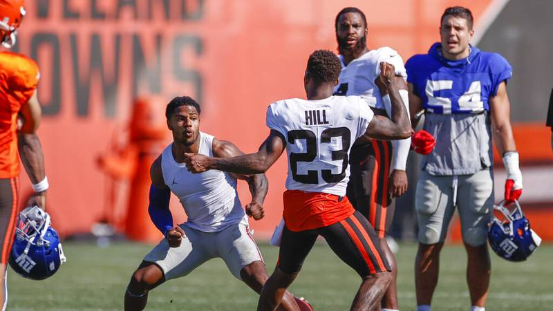 Cleveland Browns cornerback Troy Hill (23) and New York Giants wide receiver Sterling Shepard...