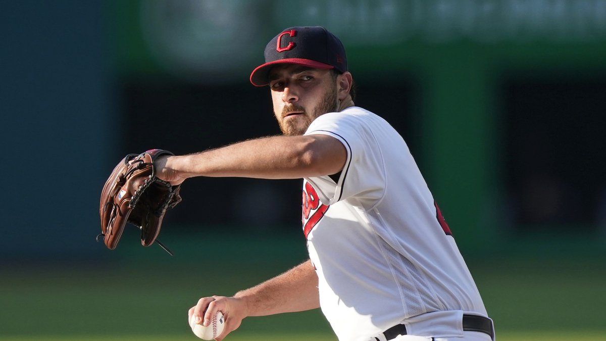 Cleveland Indians starting pitcher Aaron Civale delivers in the first inning of the team's...
