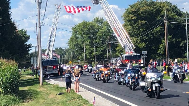 A processional bringing home the body of Navy Corpsman Maxton Soviak passed his alma mater,...