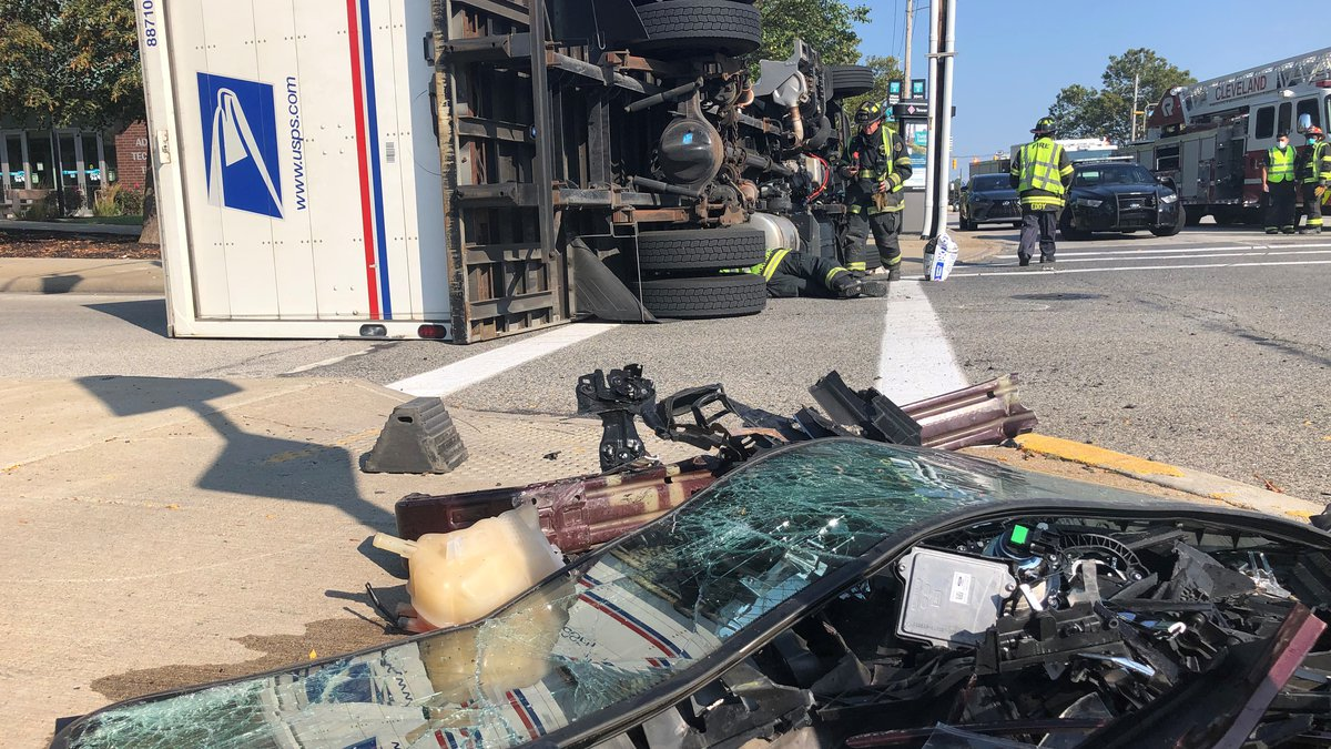 A USPS truck overturned after a crash at the intersection of East 30th Street and Woodland...