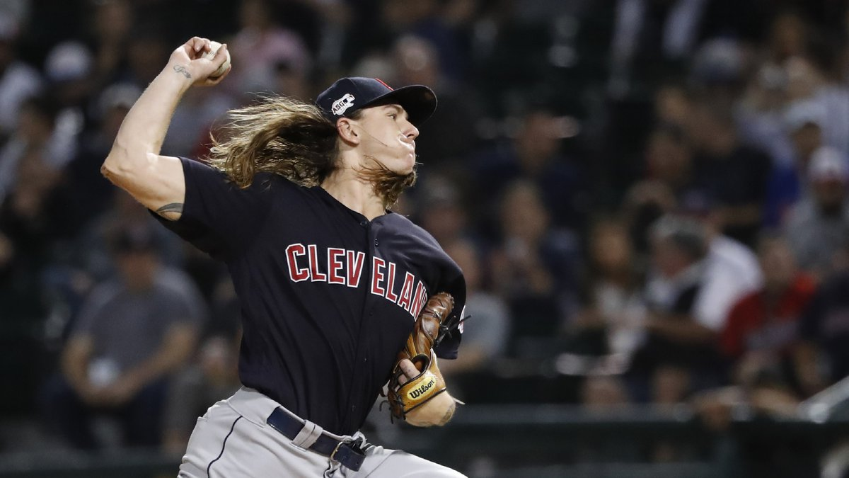 Cleveland Indians starting pitcher Mike Clevinger delivers during the first inning of a...