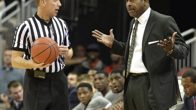 Cleveland State head coach Gary Waters, right, complains to a referee during the second half of...