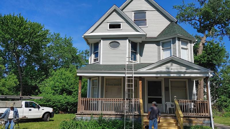 New roof and vinyl siding, plus inside plaster work gives house new lease