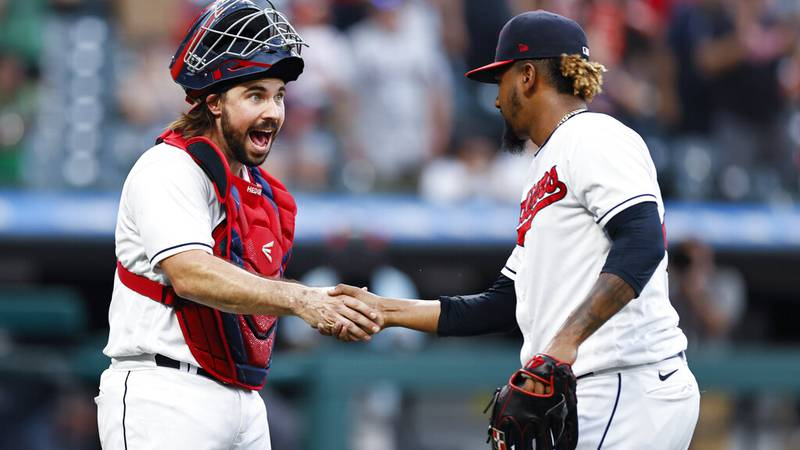 Cleveland Indians' Austin Hedges and Emmanuel Clase celebrate a victory over the Boston Red Sox...