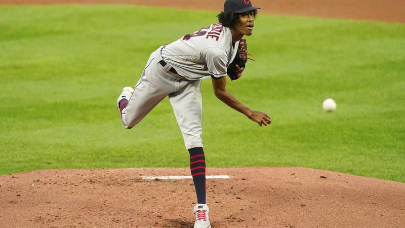 Cleveland Indians starting pitcher Triston McKenzie throws during the first inning of a...