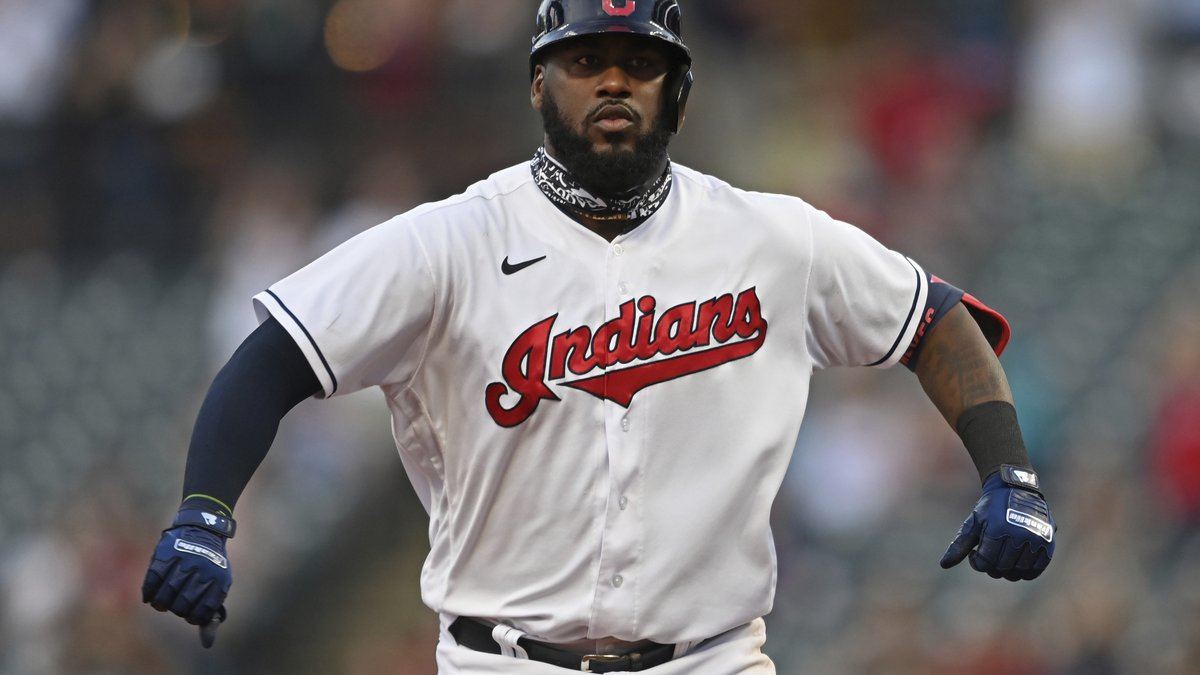 Cleveland Indians' Franmil Reyes (32) celebrates while running the bases after hitting a solo...