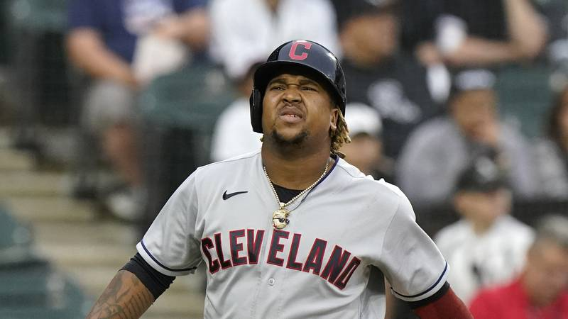 Cleveland Indians' Jose Ramirez reacts after being hit by a pitch during the first inning of a...