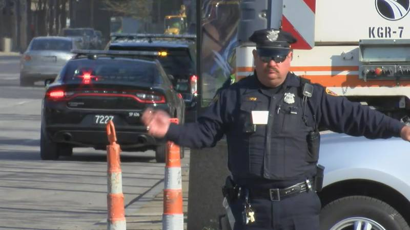 A law enforcement officer directs vehicles during a traffic jam Monday morning in Cleveland