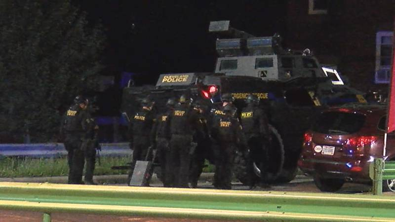 The Cleveland SWAT team closes in on a home in the west side after a report of shots fired