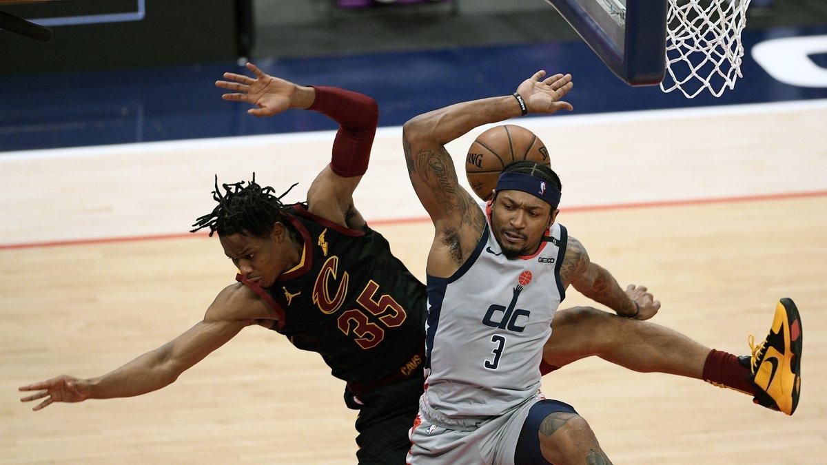 Cleveland Cavaliers forward Isaac Okoro (35) and Washington Wizards guard Bradley Beal (3)...