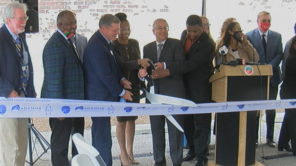 Cuyahoga County Executive Armond Budish is joined by other officials at a ribbon cutting for...