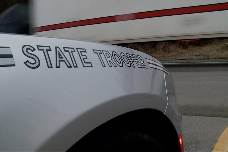Semi truck passes OSHP trooper sitting in median on US 52