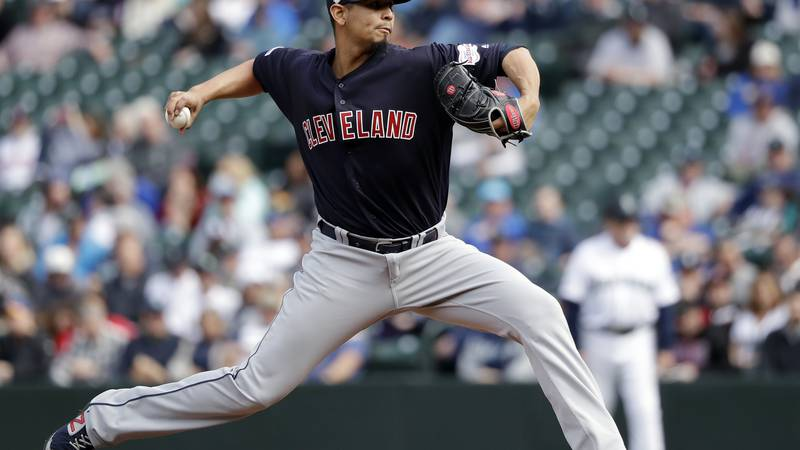 Cleveland Indians starting pitcher Carlos Carrasco throws against the Seattle Mariners during...