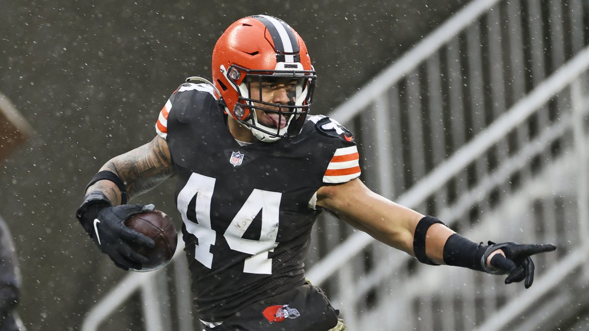 Cleveland Browns linebacker Sione Takitaki looks back as he runs for a 50-yard interception...