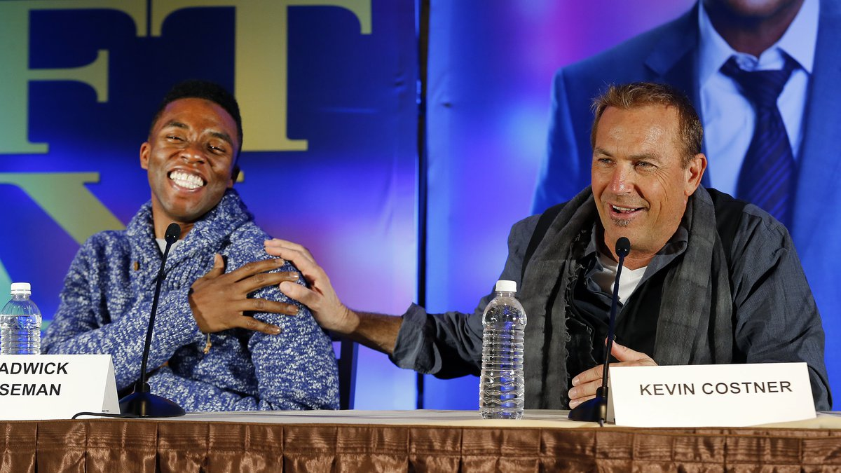 Actors Chadwick Boseman, left, and Kevin Costner appear at a news conference for the movie...