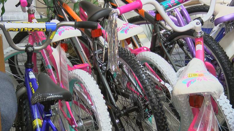 The Berrien County Sheriff's passes out bicycles, sponsored by community donations, for...