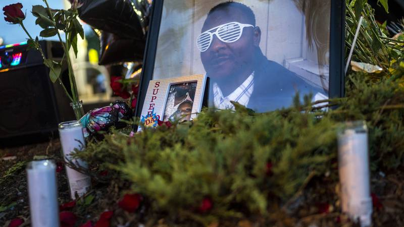 FILE - in this July 7, 2021 file photo, Items rest at a memorial for Leneal Lamont Frazier, in...