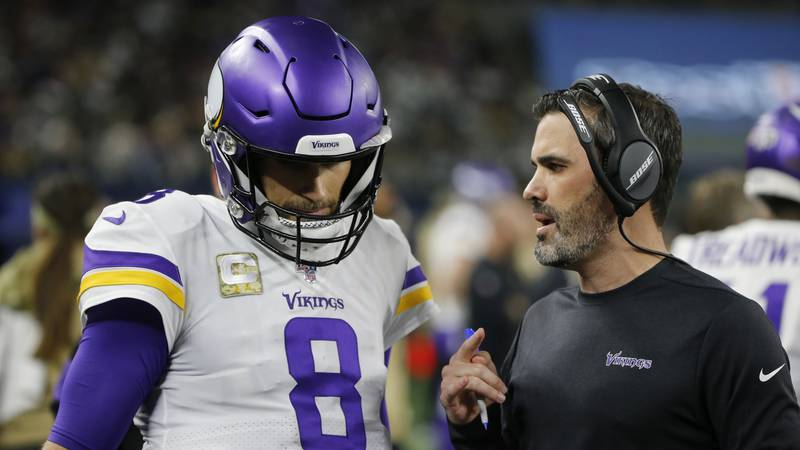 Minnesota Vikings quarterback Kirk Cousins (8) listens to offensive coordinator Kevin...