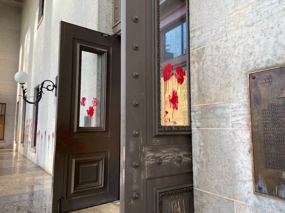 The red hand prints are reportedly to protest police brutality.