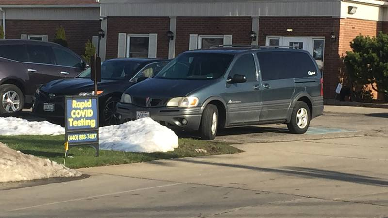 Signs outside of the MedCare Center in Parma Heights advertise rapid COVID tests, their website...