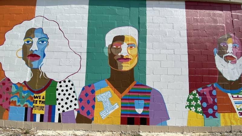 """The """"Me and My Community"""" mural was commissioned and launched as a youth-engagement initiative..."""