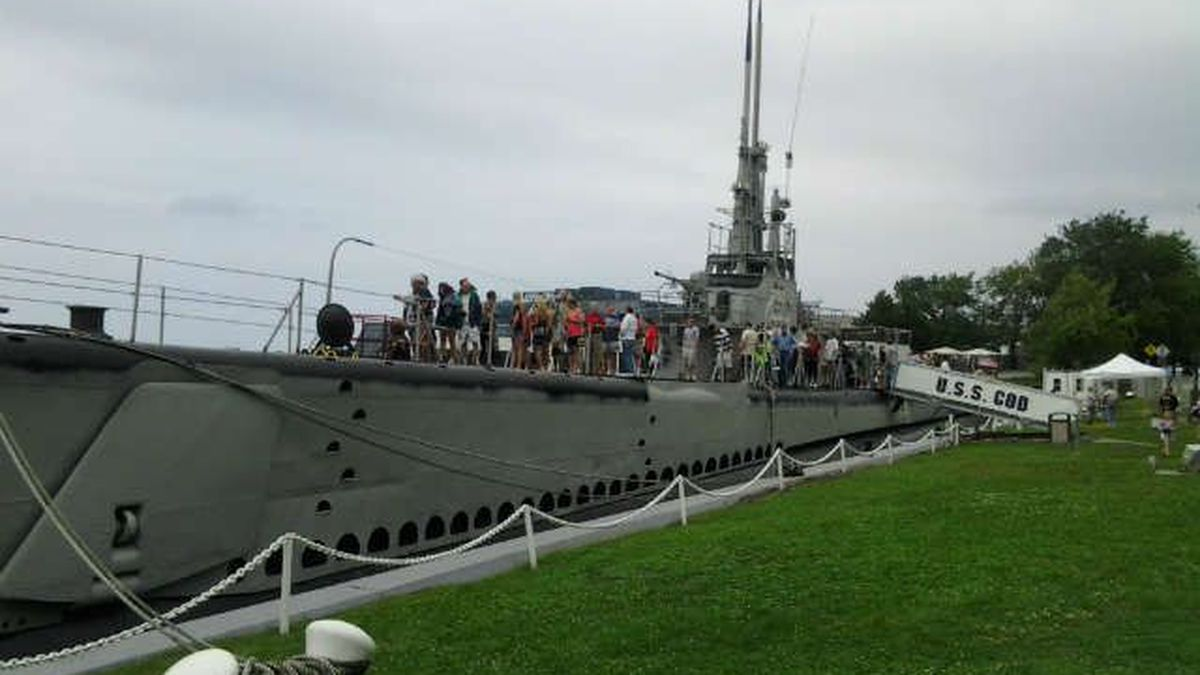 A crowd gathers on the USS COD Submarine Memorial in Cleveland. The ship will set sail Sunday...