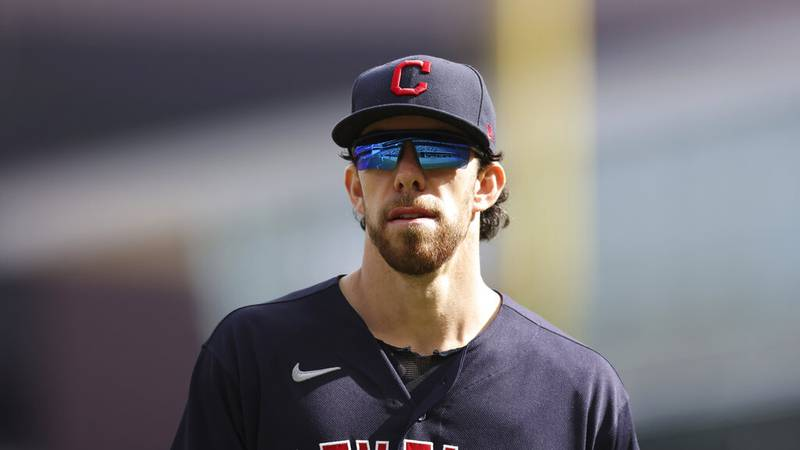 Cleveland Indians' Bradley Zimmer (4) walks to the dugout after the fourth inning of the first...