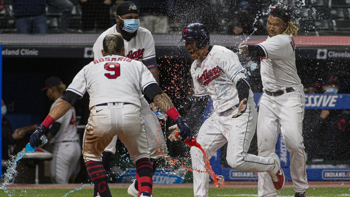 Cleveland Indians' Jordan Luplow gets drenched by his teammates after hitting a two-run home...