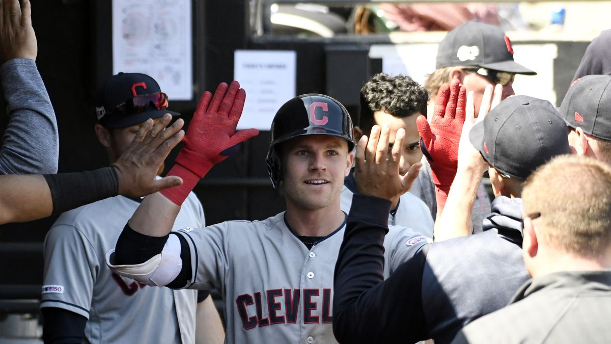 Cleveland Indians' Jake Bauers (10) is greeted in the dugout after hitting a home run against...