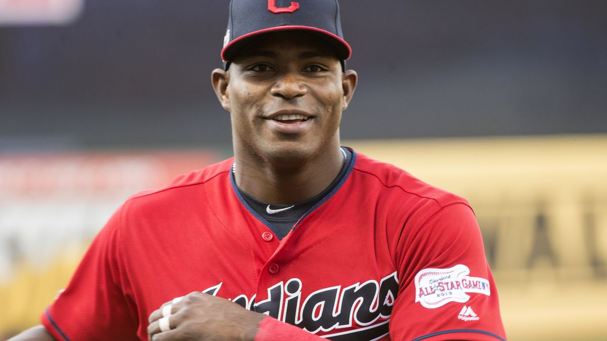Cleveland Indians' Yasiel Puig warms up before a baseball game against the Houston Astros in...