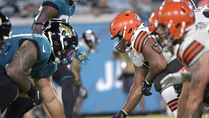 The Cleveland Browns offense, right, lines up against the Jacksonville Jaguars defense at the...