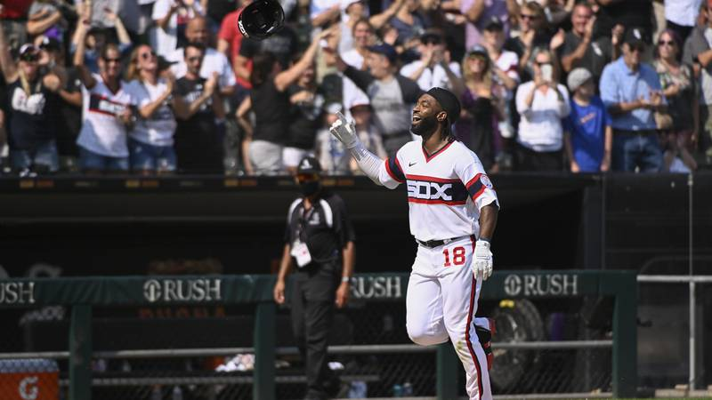 Chicago White Sox's Brian Goodwin (18) flips his helmet after hitting a walkoff home run during...
