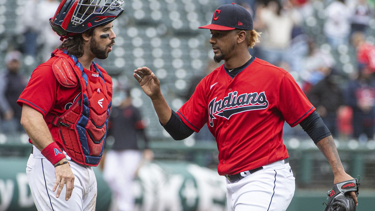 Cleveland Indians relief pitcher Emmanuel Clase is greeted by Austin Hedges after the Indians...
