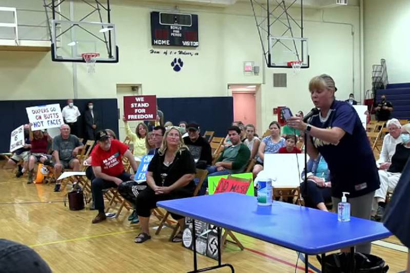 Opponents of mask mandates in schools are seen at a recent West Geauga Board of Education...