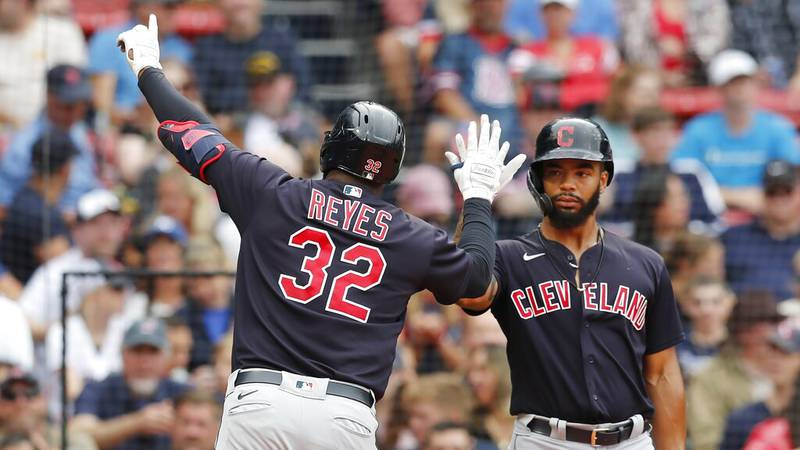 Cleveland Indians' Franmil Reyes (32) celebrates his solo home run with Bobby Bradley during...