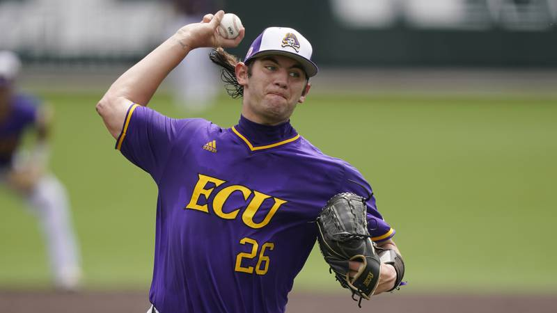 East Carolina pitcher Gavin Williams throws against Vanderbilt during the first inning of an...