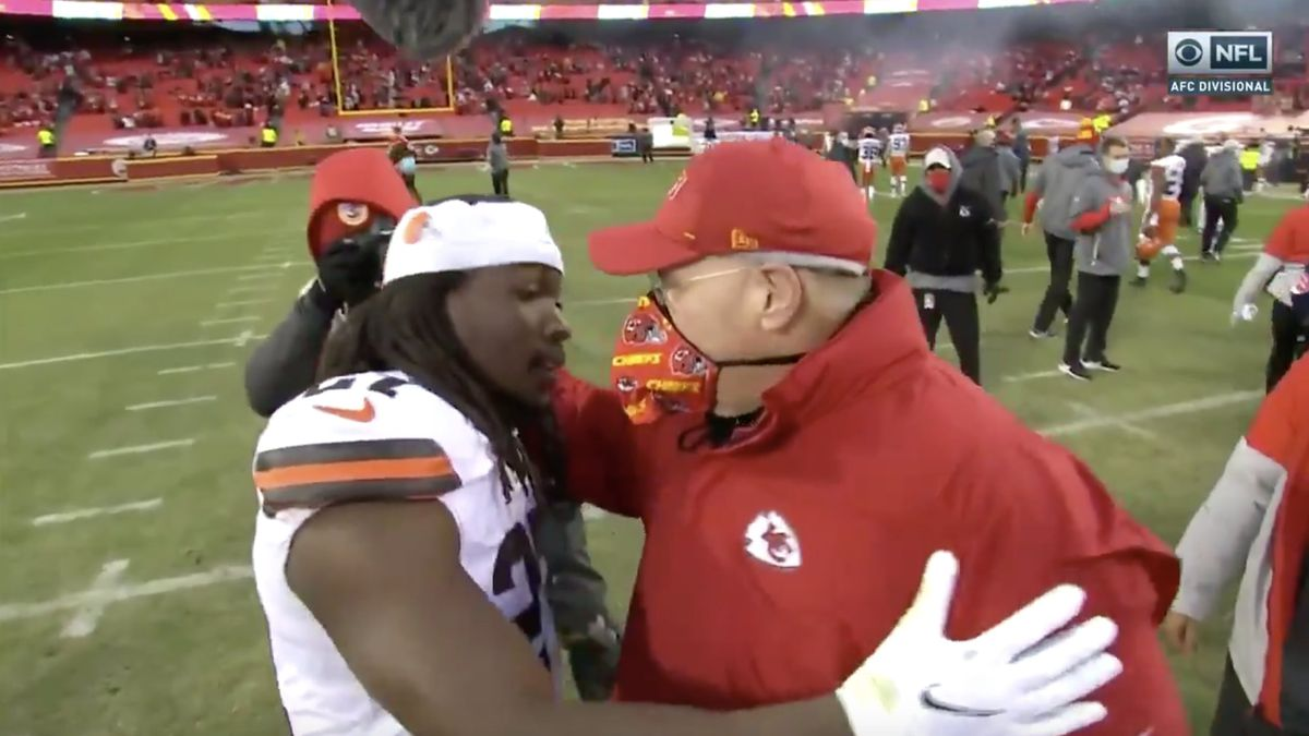 Browns' Kareem Hunt embraces his former head coach after Cleveland falls to Chiefs in AFC...