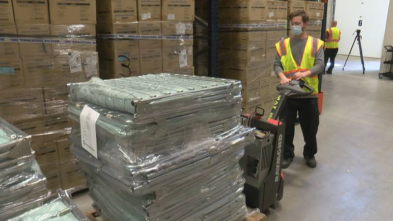 A Cleveland Clinic warehouse worker loads supplies to be shipped overseas to fight COVID-19 in...