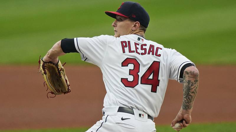 Cleveland Indians starting pitcher Zach Plesac delivers in the first inning of a baseball game...