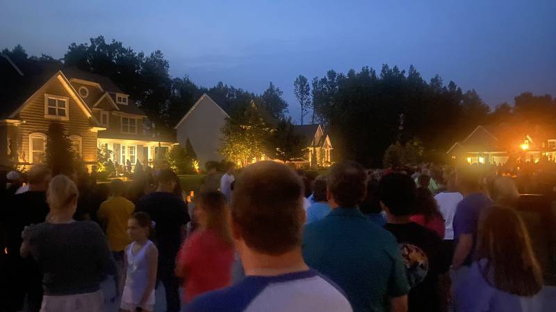 Hundreds of people paid tribute to the Hull family Monday evening with a candlelight vigil.