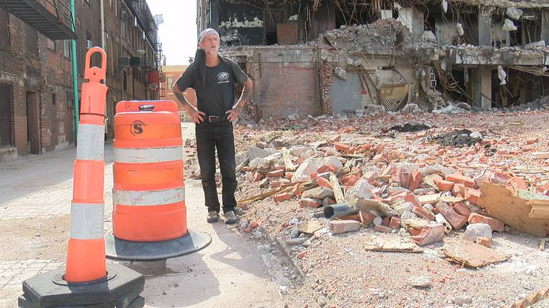 An Elyria residents stands in front of the former Uncle Vic's nightclub months after it was set...