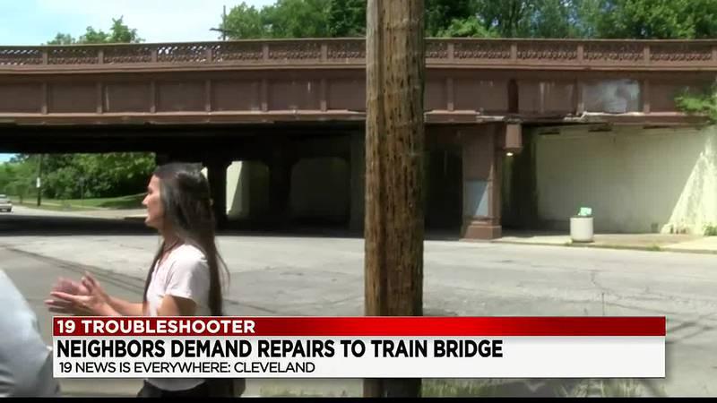 Neighbors demand repairs to train bridge