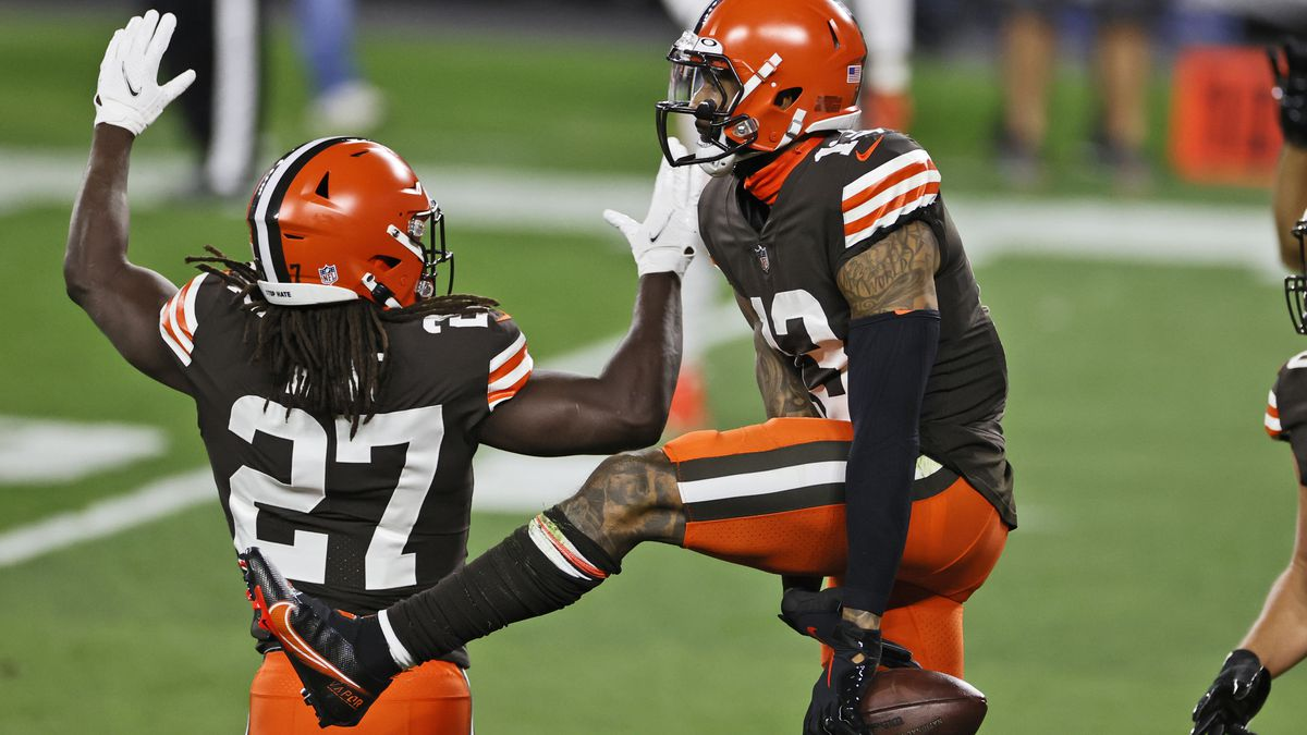 Cleveland Browns wide receiver Odell Beckham Jr., right, celebrates with running back Kareem...