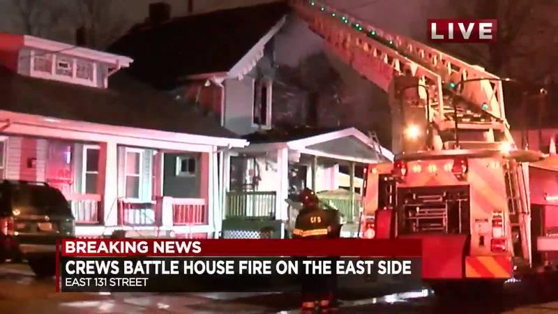 Crews battle East Side house fire.