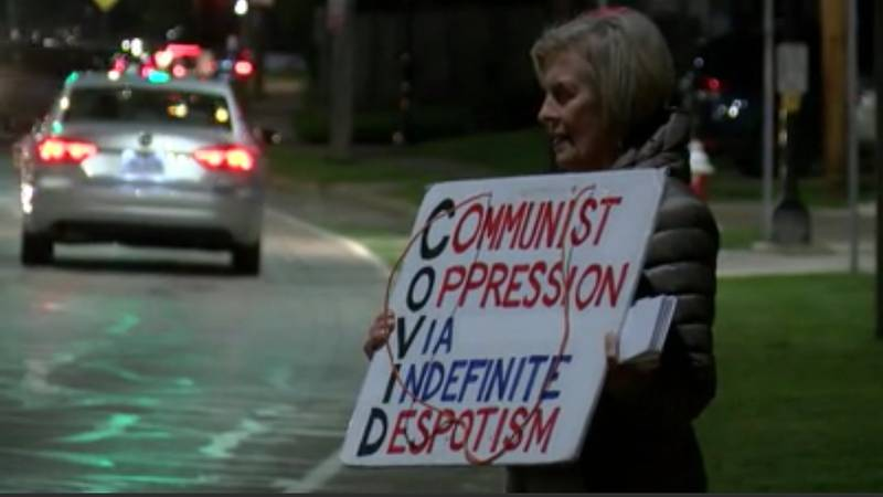 Protesters holding anti-masking signs rallied outside the Lakewood Board of Education Meeting