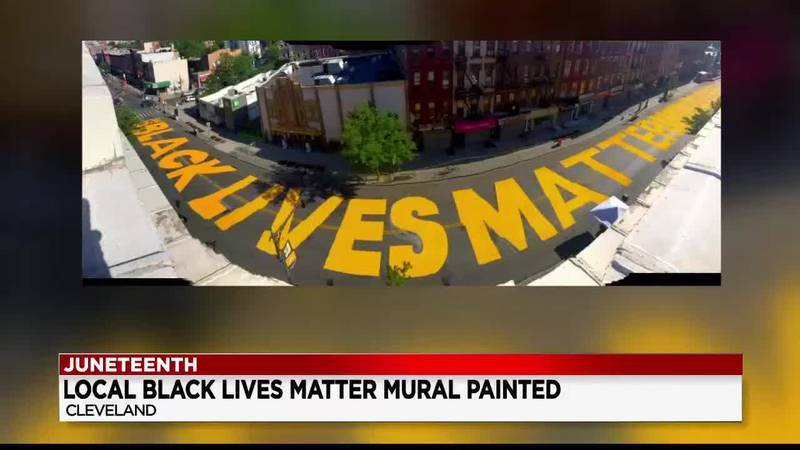 Artists paint 'Black Lives Matter' mural on East 93rd Street in Cleveland